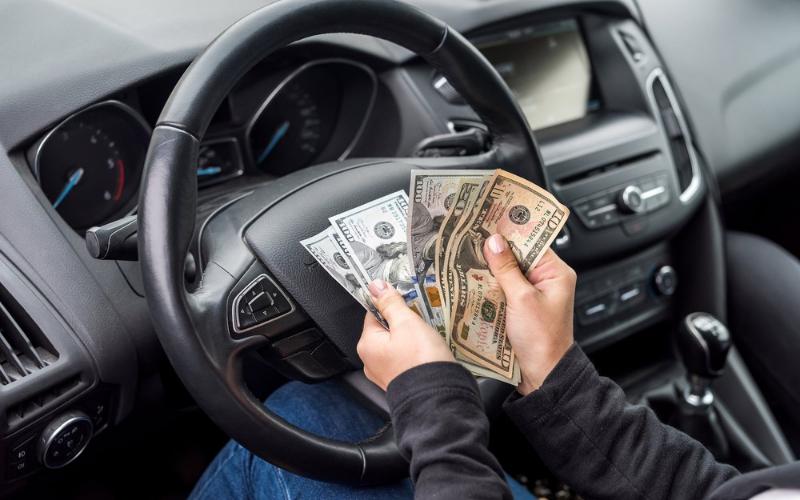 lyft vs uber driver income 2021
